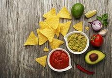 Guacamole and tomato salsa Stock Photos