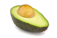 Avocado Half. An avocado freshly cut in half, with the seed still inside Stock Photo