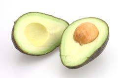 Avocado Half. Avocado sliced in half with seed in center Royalty Free Stock Photos