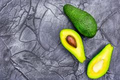 Avocado half on the black background of minimal food royalty free stock images
