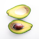 Avocado halves. On white background Stock Image