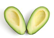 Avocado halves. Top view of two avocado halves, isolated on a white background royalty free stock image