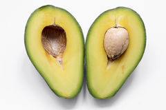 Avocado halves Royalty Free Stock Images