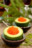 Avocado halves with red caviar Royalty Free Stock Photos