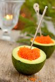 Avocado halves with red caviar Stock Images
