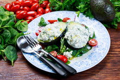 Avocado halves stuffed with cottage cheese and sunflower seeds.  Royalty Free Stock Images