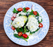 Avocado halves stuffed with cottage cheese and sunflower seeds.  Stock Image