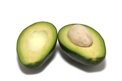 Avocado halves on a white background Stock Photo