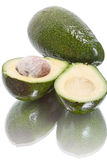 Avocado halves on white Stock Image