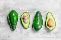 Avocado and avocado halves stock photos