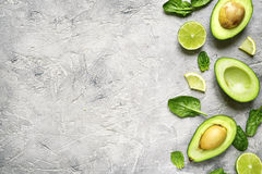 Avocado Halves With Lime Slices And Baby Spinach Leaves. Top View Stock Photography