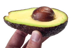Avocado in a hand Royalty Free Stock Images