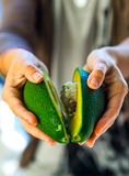 Avocado in a hand of woman Royalty Free Stock Image