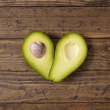 Avocado heart. On a wooden background Royalty Free Stock Images