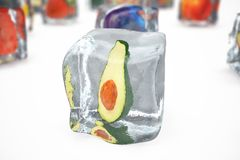 Avocado in ice cube isolated on white with depth of field effects. Ice cubes with fresh berries. Berries fruits frozen. In ice cubes. 3D rendering Royalty Free Stock Images