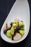 Avocado icecream with fruits. Vegan avocado icecream with litchee and molasses Royalty Free Stock Image