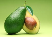 Avocado isolated on a green. Stock Photos