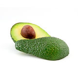 Avocado isolato su un fondo bianco Frutta saporita e sana immagini stock