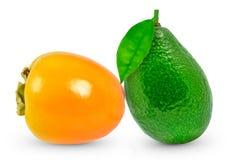 Avocado and kaki Stock Image