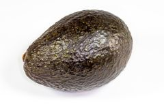 Avocado laying on the kitchen table waiting to be sliced up by the chef royalty free stock images