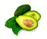 Avocado with leaf is cut Royalty Free Stock Photos