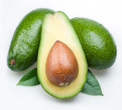 Avocado with leaves Stock Images