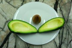 Avocado and lemon fresh green half natural nutritious royalty free stock images