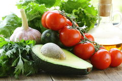 Avocado, lettuce, tomato  and oil Stock Image