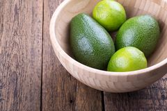 Avocado and limes stock image