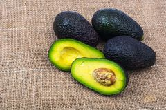 Avocado on linen napkin. Studio Photo Stock Image
