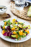 Avocado with Mango,Rocket and Walnut salad Stock Images