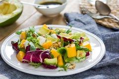 Avocado with Mango,Rocket and Walnut salad Stock Image