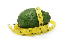 Avocado with measuring tape Stock Images