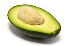 avocado met steen op een witte achtergrond Stock Afbeelding