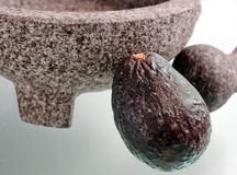 Avocado with mortar and pestle Royalty Free Stock Photo