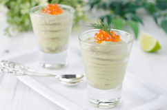 Avocado mousse with caviar and lime portions Royalty Free Stock Photography