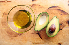 Avocado oil, avocado. Avocado oil in a bowl, avocado Royalty Free Stock Photography