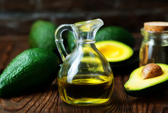 Avocado oil. In bottle and on a table stock images