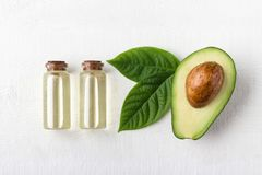 Avocado oil in glass bottle royalty free stock images
