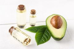 Avocado oil in glass bottles royalty free stock image