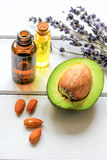 Avocado oil for handmade cosmetics with herb on wooden background Royalty Free Stock Photo