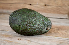 Avocado on old wooden table Royalty Free Stock Photos