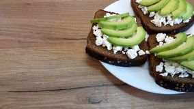Avocado on old wooden table. stock photo