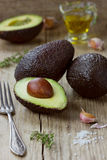 Avocado with olive oil Stock Image