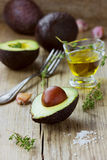Avocado with olive oil, herb thyme Stock Photography