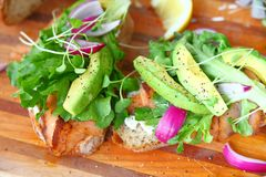 Avocado, onion and lettuce on smoked salmon stock photos