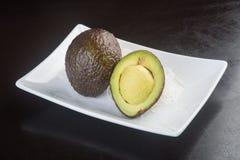 Avocado Avocado op een Achtergrond Royalty-vrije Stock Foto