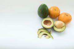 Avocado and Orange Fruits  on white background, Royalty Free Stock Image