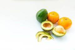 Avocado and Orange Fruits  on white background, Royalty Free Stock Photography