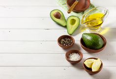 Avocado, and other ingredients for sauce guacamole on the table. Royalty Free Stock Photography
